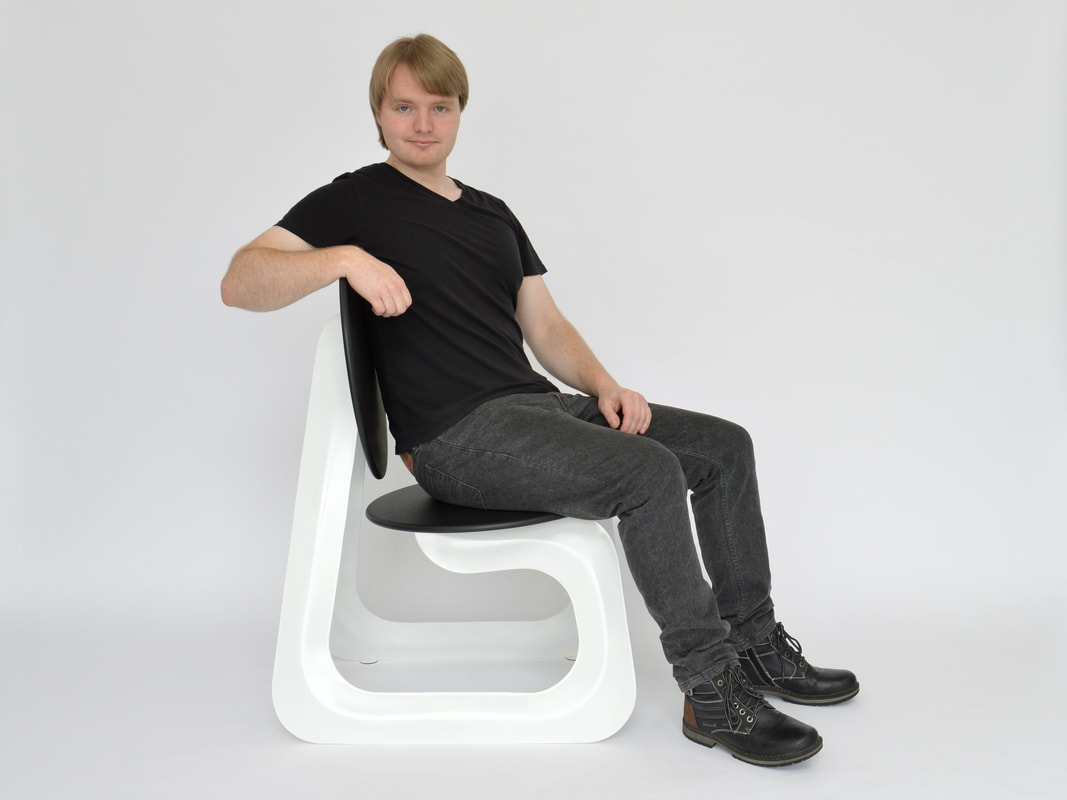Designer Maker Connor Holland with the Aeroformed Chair